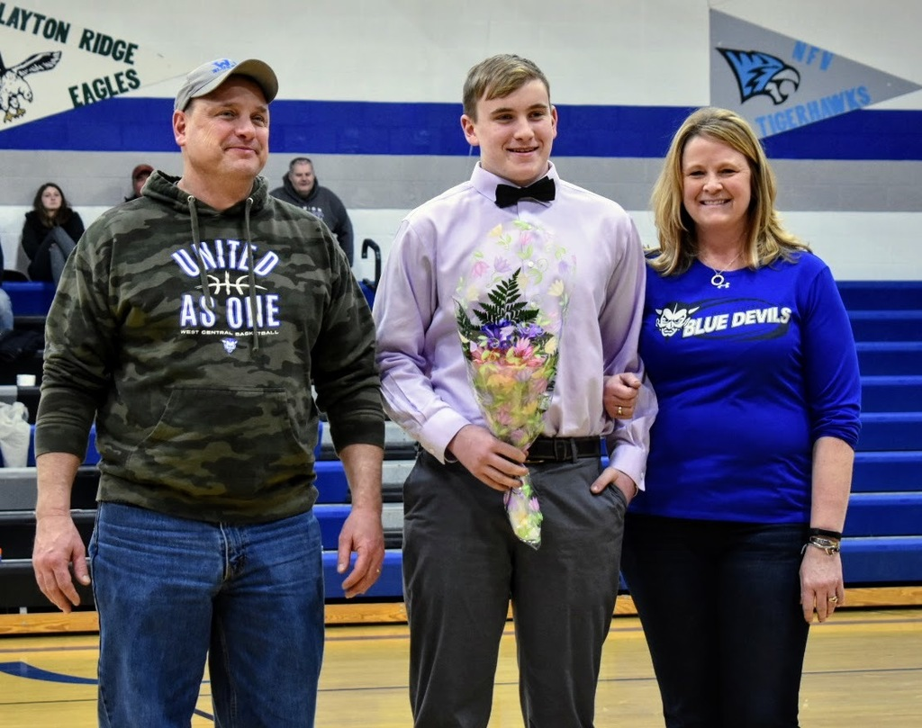 Seniors Cooper Ingels, Kaylin Kent-Thomas and Rosita Hepperle and their parents were honored